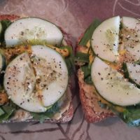 Cucumber and lemon pepper-topped open-faced sandwiches